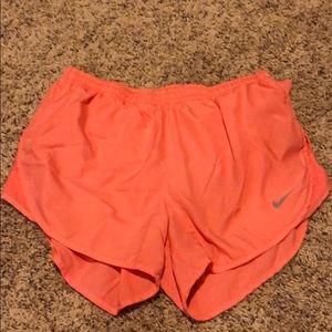Coral Nike running shorts